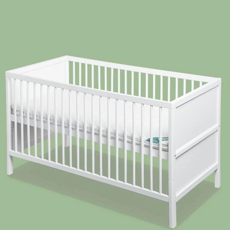 white baby cot bed